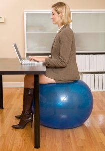 Sitting at desk on swiss ball